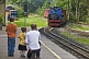 Image of Father and 2 sons photograph approaching steam train at Kirklees Light Railway at Clayton West.
