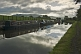 Image of Narrowboats moored on the Leeds Liverpool Canal at Broughton Road on cloudy day.