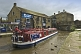 Image of Penine Boat Trips wide beam canal barge boat mooring at Belmont Street Bridge.