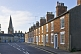 Image of Terraced brick cottages on Olney High Street towards Saint Peter and Saint Paul church.