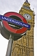 Image of London Underground tube sign outside Big Ben clock tower and Houses of Parliament.
